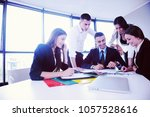 group of happy young  business... | Shutterstock . vector #1057528616