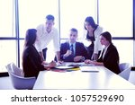 group of happy young  business... | Shutterstock . vector #1057529690