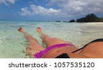 girl laying in surf with clouds ... | Shutterstock . vector #1057535120