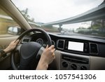 driver hands on wheel driving... | Shutterstock . vector #1057541306