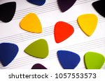 Colorful Guitar Picks On A An...