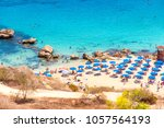 people at the famous beach of... | Shutterstock . vector #1057564193
