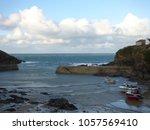 cornish coastal village | Shutterstock . vector #1057569410