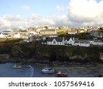 cornish coastal village | Shutterstock . vector #1057569416