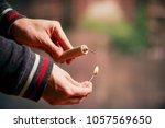 close up of man hand lighting... | Shutterstock . vector #1057569650