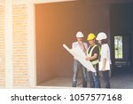 architect and engineer inspect... | Shutterstock . vector #1057577168