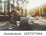 aged entrepreneur in overalls...   Shutterstock . vector #1057577444