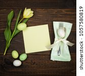 easter place setting with... | Shutterstock . vector #1057580819