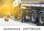 oil and gas workers fueling... | Shutterstock . vector #1057582220