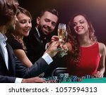 friends drinking and... | Shutterstock . vector #1057594313