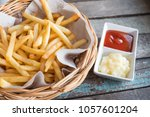 fresh fried french fries. | Shutterstock . vector #1057601204