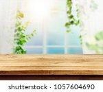 wooden board empty table | Shutterstock . vector #1057604690