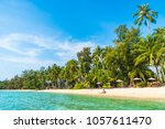 beautiful tropical beach and... | Shutterstock . vector #1057611470