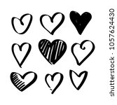set of nine hand drawn heart.... | Shutterstock .eps vector #1057624430