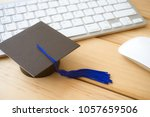 graducate cap on keyboard with... | Shutterstock . vector #1057659506