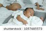 young beautiful asian mother... | Shutterstock . vector #1057685573