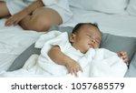 young beautiful asian mother... | Shutterstock . vector #1057685579