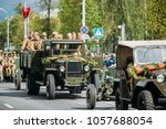 Small photo of Gomel, Belarus - May 9, 2017: Group Of Re-enactos Dressed As Russian Soviet Soldiers Of World War II Sitting In Truck ZIS-5V And Taking Part In Parade During Celebration Of Victory Day 9 May