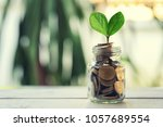 glass of gold coins inside and... | Shutterstock . vector #1057689554