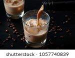 pouring irish cream in a glass... | Shutterstock . vector #1057740839