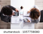 side view of two young... | Shutterstock . vector #1057758080