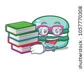 student wiith book macaron... | Shutterstock .eps vector #1057770308