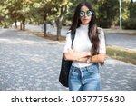 hipster girl wearing khaki... | Shutterstock . vector #1057775630
