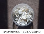 Small photo of Egg shell on the table. Calcium carbonate, found naturally in the form of minerals, is part of the egg shell. Used in everyday life to alkalize the soil in gardening.