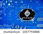 Small photo of Shining silver metal ETH Ethereum coin on computer mother board