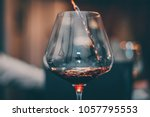 tasting red wine glass   close... | Shutterstock . vector #1057795553