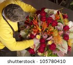 florist finishing beautiful and ... | Shutterstock . vector #105780410