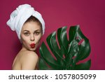 beautiful woman with a palm... | Shutterstock . vector #1057805099