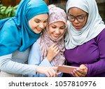 islamic women using smartphone | Shutterstock . vector #1057810976