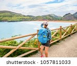 lonely pilgrim with backpack... | Shutterstock . vector #1057811033