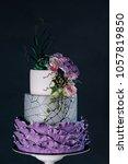 White Wedding Cake With Purple...