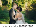 happy smiling stylish bride and ...   Shutterstock . vector #1057832903