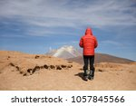 young man looking at view at... | Shutterstock . vector #1057845566