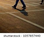 people are walking across the... | Shutterstock . vector #1057857440