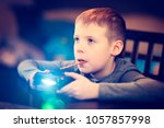 Small photo of The boy is playing a TV game