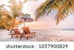 beautiful sunset beach scene.... | Shutterstock . vector #1057900829