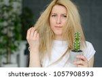 damaged hair. beautiful sad...   Shutterstock . vector #1057908593