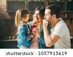 family drink juice in the... | Shutterstock . vector #1057915619