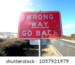 Wrong Way Go Back Sign Concept