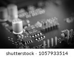 Small photo of Circuit board with resistors microchips and electronic components. Electronic computer hardware technology. Integrated communication processor. Information engineering component. Selective focus.