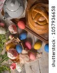 Small photo of Portuguese traditional Easter cake. Folar with eggs on wooden table