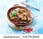 traditional greek moussaka... | Shutterstock . vector #1057942049