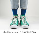 stylish  bright  green sneakers ... | Shutterstock . vector #1057942796
