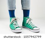 stylish  bright  green sneakers ... | Shutterstock . vector #1057942799