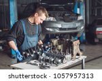 master collects a rebuilt motor ... | Shutterstock . vector #1057957313