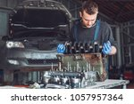 master collects a rebuilt motor ... | Shutterstock . vector #1057957364